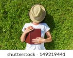 girl sleep on the field with...   Shutterstock . vector #149219441