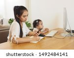 asian mother busy working while ... | Shutterstock . vector #1492484141