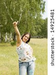 gesturing woman in a summer forest - stock photo