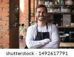 happy confident young waiter... | Shutterstock . vector #1492617791