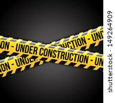 under construction ribbons over black background vector illustration