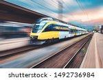 High speed yellow train in...