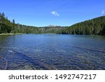 Todd Lake, Oregon, with Broken Top in background on a clear sunny summer afternoon.