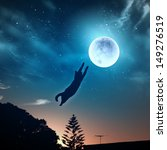 Stock photo image of cat in jump catching moon 149276519