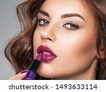 young beautiful girl paints... | Shutterstock . vector #1493633114