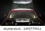 Automotive Concept. Car in a Car Wash at Night. Automatic Washing Modern Vehicle.  - stock photo