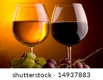 a glass of white wine  grape and a glass of red wine - stock photo