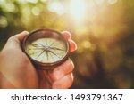 Trial Hiking with Compass Device in a Hand. Hikers Equipment. Travel and Recreation Industry. - stock photo
