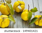 Ripe Quinces On Wooden Table