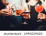Small photo of Clinking glasses with alcohol and toasting, party. Congratulations to the event. Cheerful party friends. man with a car key, sobriety concept