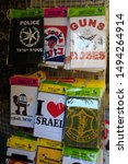 Small photo of Jerusalem / Israel - September 13, 2010: Shops in Old Town Jerusalem sell a variety of kitschy t-shirts and souvenirs to tourists.