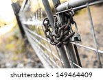 A Padlock On A Steel Chain Lin...