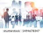 Small photo of Business people working together in stylish office with double exposure of cityscape and graphs. Concept of trading and stock market. Toned image