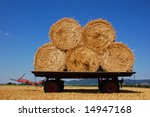 Balls of hay on an agriculture trailer - stock photo