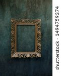 Small photo of Vintage openwork bronze metal frame on a old wall background