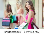 happy shopping woman with a... | Shutterstock . vector #149485757