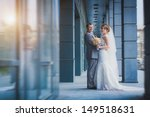 happy newlyweds against a blue... | Shutterstock . vector #149518631