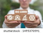 Small photo of ISO 22000 Food Standard Assurance Control Certification. Man holding wooden blocks with iso 22000 certificate.