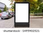 Small photo of advertising space under the poster. Lightposter citylight mockup small billboard in the city near the roadway. white space for advertising