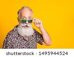 Small photo of Close up photo of astonished man seeing something strange in front of him while isolated with yellow background
