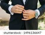 Hands Of Wedding Groom In A...