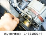 Small photo of On a bad big old starter, tighten the iron bolt with a wrench. Car repair.