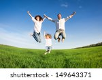 happy family jumping in green... | Shutterstock . vector #149643371