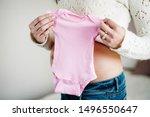 Pregnant Woman Holding Bodysuit ...