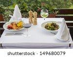 Beautiful served food on plates - stock photo