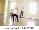 two men with ladder in empty... | Shutterstock . vector #14969683
