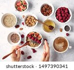 Small photo of healthy oatmeal breakfast with raspberries and finns, chia and flax seeds and honey, pattern, top visas, good morning concept