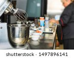 Small photo of Confectionery Background, Confectionery Concept. Closeup of planetary mixer, copy space for text. Cooking cake and pastries in the kitchen of the restaurant. Closeup of planetary mixer