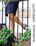 female legs on balcony among... | Shutterstock . vector #1498216757