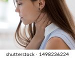 Small photo of Unhealthy young woman touch neck hard to swallow having discomfort or painful feeling, unwell sad female employee suffering from angina or tonsillitis, sore throat, experience loss of voice