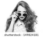 Portrait of beautiful woman in sunglasses on white background. Fashion photo - stock photo
