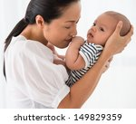 Mother Carrying Her Baby With...