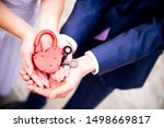 Newlyweds Are Holding In Their...