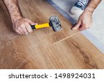 Small photo of Hammer or mallet - needed to fit and perform an accurate connection of the floor slats - using a hammer to either snap the individual boards or tamp them