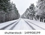 Snowy Street Through Forest