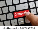 Stock photo close up of finger on keyboard button with complaint button index finger touching complaint keypad 1499251934