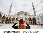Young Woman Traveler In Hat An...
