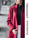 Small photo of girl in a warm light coat outdoors. model in outerwear. brunette in a long red coat walks around the city. beautiful girl in a fashionable casual coat. spring autumn collection.