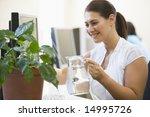 woman in computer room watering ... | Shutterstock . vector #14995726