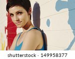 Small photo of Closeup portrait of a smiling fashionable impish young woman