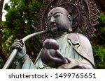 A Buddha statue on the grounds of Sensoji (Asakusa Kannon Temple), a Buddhist temple in Asakusa, Tokyo, Japan, photographed in summer