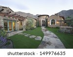 paved pathway along yard to...   Shutterstock . vector #149976635