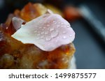 Stock photo water drops on a rose petal on top of a citrine crystal cluster pink rose petal golden healing 1499875577