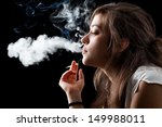Woman Smoking A Cigarette On...