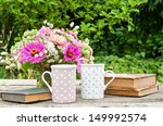 Two Coffee Mugs Old Books And...