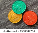 Small photo of Guadalajara, Mexico - September 9 2019: AA Sobriety chips awarded abstaining from alcohol or other substance for for 8, 10 and 11 months. It is a token given to 12 step group members. Successful rehab
